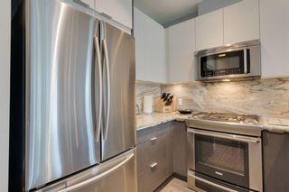 Photo 15: 113 Confluence Mews SE in Calgary: Downtown East Village Row/Townhouse for sale : MLS®# A1138938