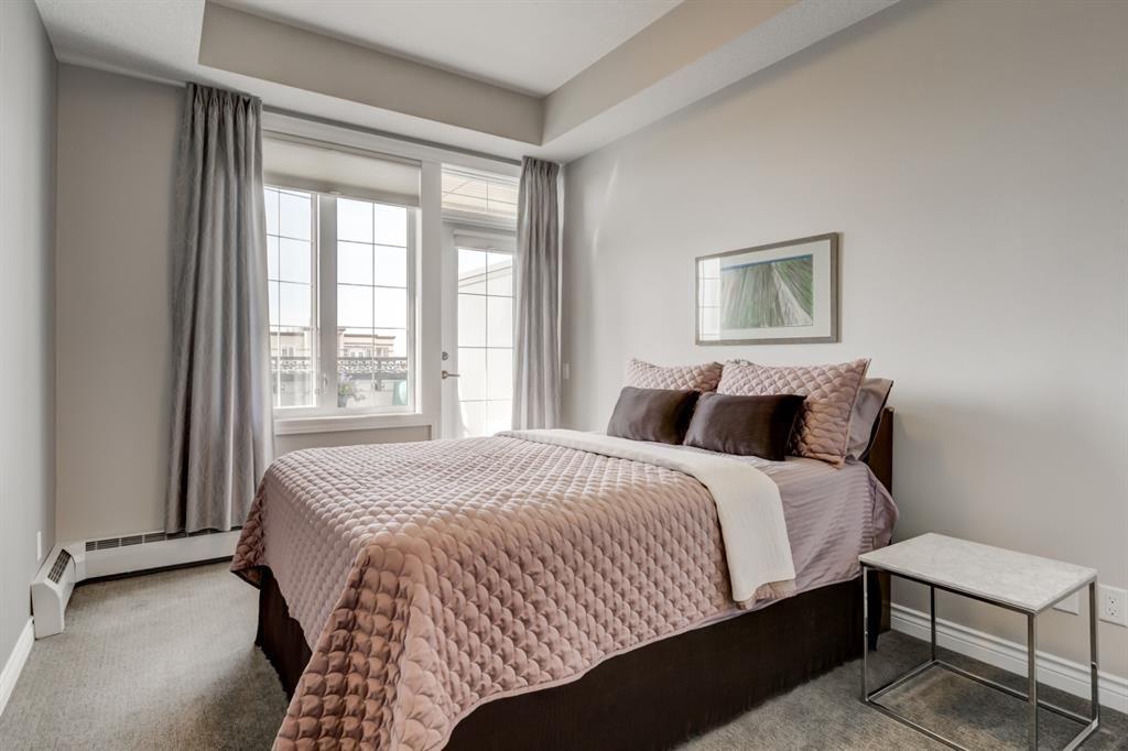 Photo 16: Photos: 312 39 Quarry Gate SE in Calgary: Douglasdale/Glen Apartment for sale : MLS®# A1103022