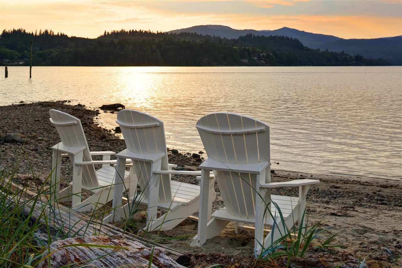 The beach is outside your door step. Enjoy watching all the activities on Porpoise Bay.