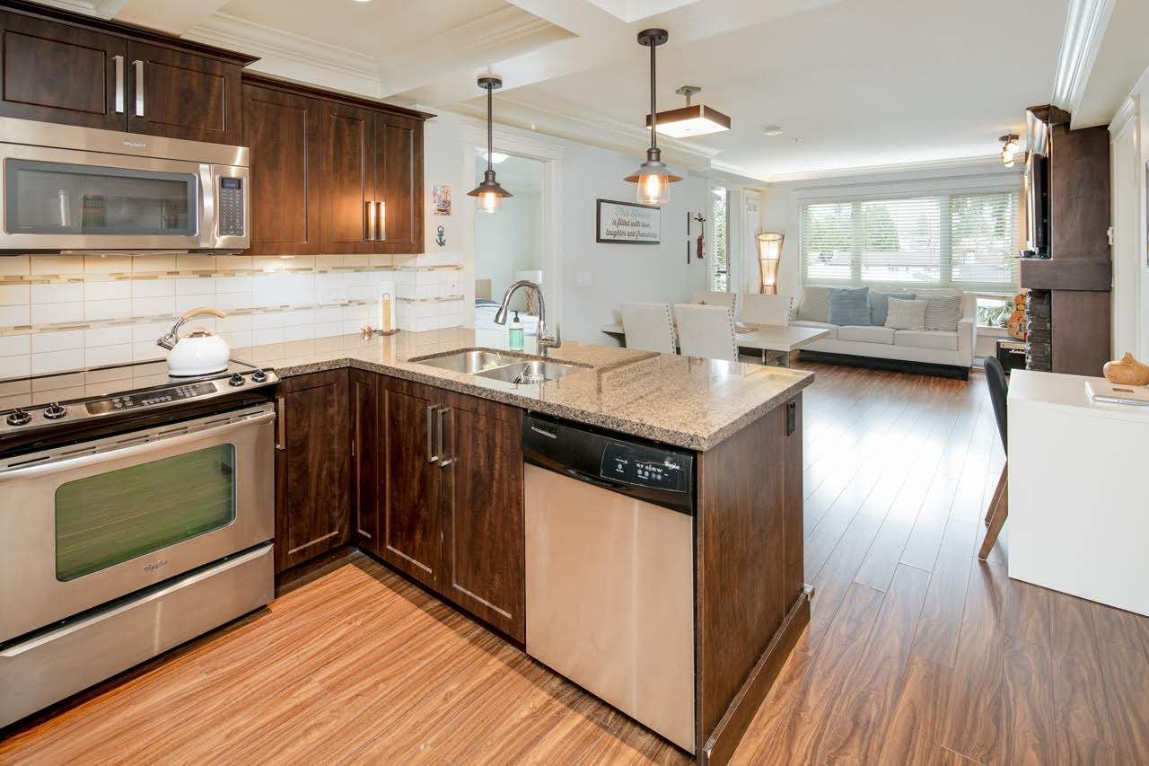 NORTH/SOUTH facing. ATTENTION to DETAIL: stone counters, extensive crown mouldings/finishings throughout. High end cabinets & appliances, wood floors. Floorplan attached