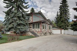 Photo 1: 4 Commerce Street NW in Calgary: Cambrian Heights Detached for sale : MLS®# A1103120