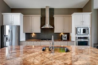 Photo 7: 219 Springbluff Heights SW in Calgary: Springbank Hill Detached for sale : MLS®# A1047010