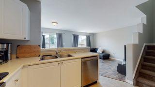 Photo 6: 11411 169 Avenue in Edmonton: Zone 27 House Half Duplex for sale : MLS®# E4254972
