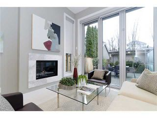 Photo 1: 2046 WHYTE AV in Vancouver: Kitsilano Condo for sale (Vancouver West)  : MLS®# V999725