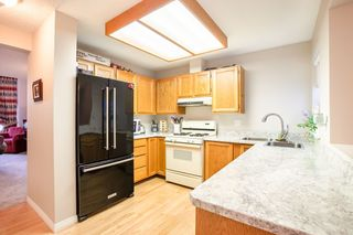 """Photo 4: 8229 VIVALDI Place in Vancouver: Champlain Heights Townhouse for sale in """"ASHLEIGH HEIGHTS"""" (Vancouver East)  : MLS®# R2331263"""