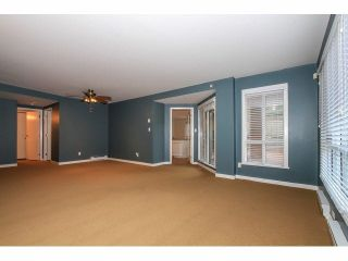 "Photo 6: 103 9978 148TH Street in Surrey: Guildford Condo for sale in ""HIGHPOINT GARDENS"" (North Surrey)  : MLS®# F1430440"