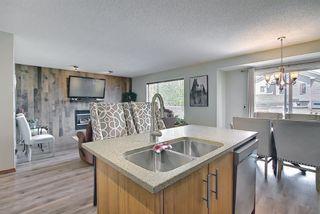 Photo 8: 140 Douglas Ridge Green SE in Calgary: Douglasdale/Glen Detached for sale : MLS®# A1114470