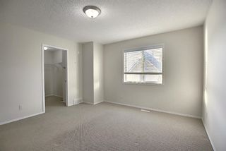 Photo 18: 25 Tuscany Springs Gardens NW in Calgary: Tuscany Row/Townhouse for sale : MLS®# A1053153