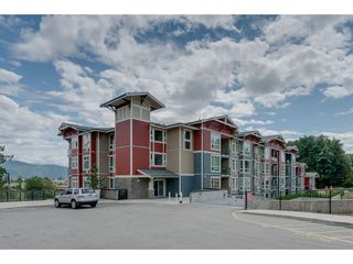 """Photo 1: 410 2242 WHATCOM Road in Abbotsford: Abbotsford East Condo for sale in """"~The Waterleaf~"""" : MLS®# R2372629"""