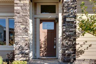 Photo 3: 40 Cougar Ridge Landing SW in Calgary: Cougar Ridge Row/Townhouse for sale : MLS®# A1148928