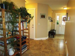 """Photo 2: 10420 109TH Street in Fort St. John: Fort St. John - City NW 1/2 Duplex for sale in """"SUNSET RIDGE"""" (Fort St. John (Zone 60))  : MLS®# N231276"""