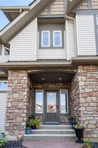 Photo 4: 1124 Panamount Boulevard NW in Calgary: Panorama Hills Detached for sale : MLS®# A1144513