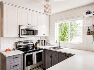 Photo 7: 63 Amiens Crescent in Calgary: Garrison Woods Semi Detached for sale : MLS®# A1098899