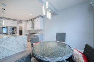 Photo 18: 48 Tremblant Terrace SW in Calgary: Springbank Hill Detached for sale : MLS®# A1131887