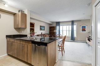 Photo 8: 1407 625 Glenbow Drive: Cochrane Apartment for sale : MLS®# A1110901