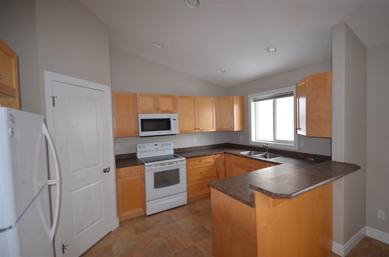 Main Photo: 8803 85 Avenue in Fort St. John: Fort St. John - City SE 1/2 Duplex for sale (Fort St. John (Zone 60))  : MLS®# R2448442