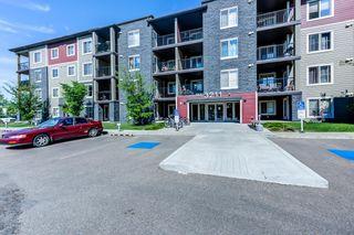 Photo 2: 406 3211 JAMES MOWATT Trail in Edmonton: Zone 55 Condo for sale : MLS®# E4248053