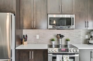 Photo 8: 1303, 881 Sage Valley Boulevard NW in Calgary: Sage Hill Row/Townhouse for sale : MLS®# A1095405