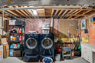 Photo 19: 14 Queen Anne Close SE in Calgary: Queensland Row/Townhouse for sale : MLS®# A1146388