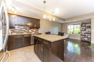 Photo 8: 110 10540 56 Avenue in Edmonton: Zone 15 Townhouse for sale : MLS®# E4248821