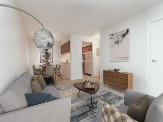 "Photo 2: 208 2110 CORNWALL Avenue in Vancouver: Kitsilano Condo for sale in ""Seagate Villa"" (Vancouver West)  : MLS®# R2515614"