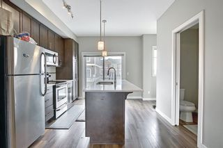 Photo 11: 63 Redstone Circle NE in Calgary: Redstone Row/Townhouse for sale : MLS®# A1141777