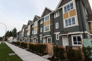 """Photo 1: 19A 14388 103 Avenue in Surrey: Whalley Townhouse for sale in """"THE VIRTUE"""" (North Surrey)  : MLS®# R2033952"""