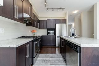 """Photo 7: 101 1125 KENSAL Place in Coquitlam: New Horizons Townhouse for sale in """"KENSAL WALK AT WINDSOR GATE"""" : MLS®# R2384199"""