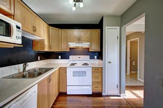 Photo 4: 129 Sandpiper Lane NW in Calgary: Sandstone Valley Row/Townhouse for sale : MLS®# A1106631
