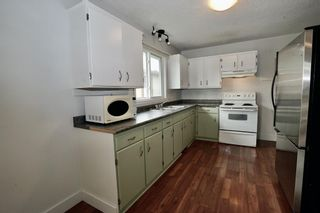 Photo 4: 11427A 8 Street SW in Calgary: Southwood Row/Townhouse for sale : MLS®# A1035689