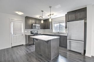 Photo 7: 216 Cranford Mews SE in Calgary: Cranston Row/Townhouse for sale : MLS®# A1134650