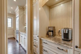 Photo 11: 111 Elmont Rise SW in Calgary: Springbank Hill Detached for sale : MLS®# A1099566