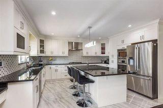Photo 1: 12712 114A Avenue in Surrey: Bridgeview House for sale (North Surrey)  : MLS®# R2451026