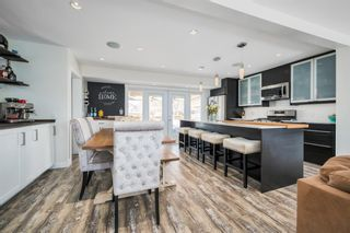 Photo 7: 3431 32 Street SW in Calgary: Rutland Park Detached for sale : MLS®# A1081195