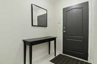 "Photo 2: 105 20200 54A Avenue in Langley: Langley City Condo for sale in ""MONTEREY GRANDE"" : MLS®# F1438210"