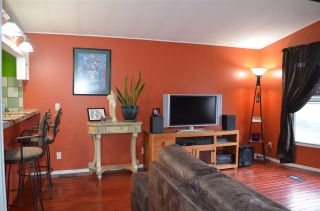 """Photo 4: 102 8224 134 Street in Surrey: Queen Mary Park Surrey Manufactured Home for sale in """"WESTW00D GATE"""" : MLS®# R2249343"""