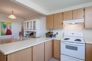 Photo 21: 332 Queenston Heights SE in Calgary: Queensland Row/Townhouse for sale : MLS®# A1114442