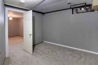 Photo 16: 22 Rossburn Crescent SW in Calgary: Rosscarrock Detached for sale : MLS®# A1083090