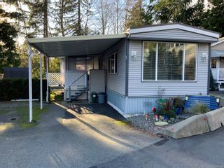 Photo 1: 7 5931 N Island Hwy in : Na Pleasant Valley Manufactured Home for sale (Nanaimo)  : MLS®# 865646