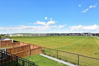 Photo 11: 4 EMBERSIDE Glen: Cochrane Detached for sale : MLS®# A1009934