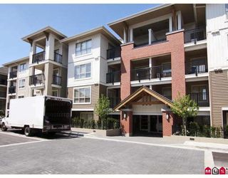 "Photo 1: E409 8929 202 Street in Langley: Walnut Grove Condo for sale in ""THE GROVE"" : MLS®# F2909591"
