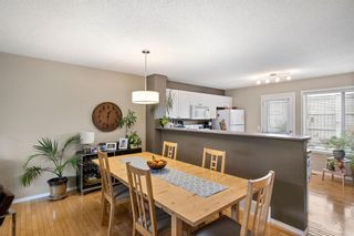 Photo 11: 69 Tuscany Springs Gardens NW in Calgary: Tuscany Row/Townhouse for sale : MLS®# A1112566