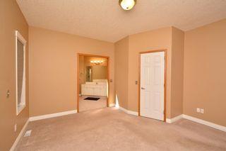 Photo 30: 303 GLENEAGLES View: Cochrane House for sale : MLS®# C4130061