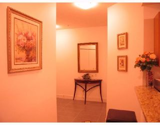 """Photo 2: 105 6033 KATSURA Street in Richmond: McLennan North Condo for sale in """"THE RED I"""" : MLS®# V679082"""
