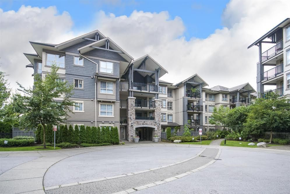 Main Photo: 104 2958 WHISPER WAY in Coquitlam: Westwood Plateau Condo for sale : MLS®# R2099902