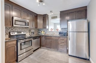 Photo 5: 39 Panatella Road NW in Calgary: Panorama Hills Row/Townhouse for sale : MLS®# A1124667