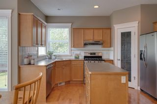 Photo 10: 140 Strathlea Place SW in Calgary: Strathcona Park Detached for sale : MLS®# A1145407
