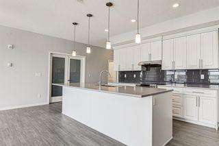 Photo 9: 410 4250 Seton Drive SE in Calgary: Seton Apartment for sale : MLS®# A1140732