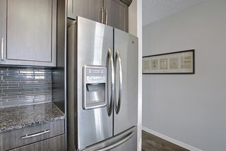 Photo 12: 731 101 Sunset Drive: Cochrane Row/Townhouse for sale : MLS®# A1077505