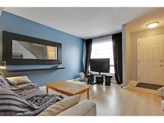 Photo 4: 52 2727 RUNDLESON Road NE in Calgary: Rundle Townhouse for sale : MLS®# C3650032